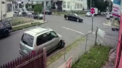 Guy on scooter blows a stop sign