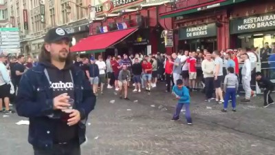 English hooligans are mocking at gipsy children throwing them coins