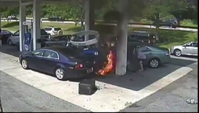 Off Duty Cop Pulls Man From Fiery Gas Station Crash