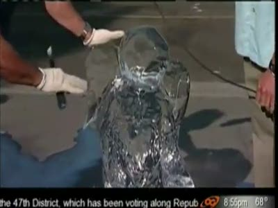 Reporter Destroys Ice Sculpture