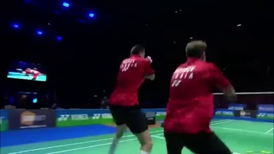 Russian badminton players celebrate win by performing the Haka