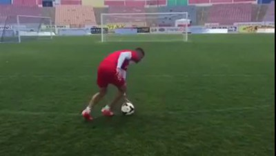 Spin around the ball 13 times without taking your eyes away and then try to score...