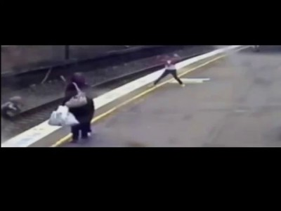 Incredible Video Shows Woman Save Child on Train Tracks with Only Seconds to Spare