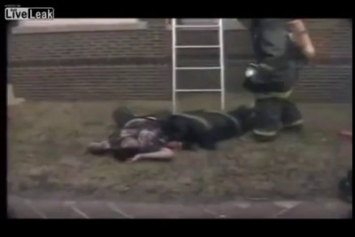 Firefighter rescuing victim takes a bad fall