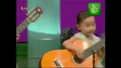 Корейские дети зажигают на гитарах,North Korea children playing the guitar. Creepy as hell