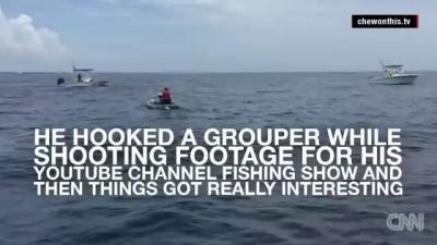 Watch shark flip over kayaker in middle of ocean