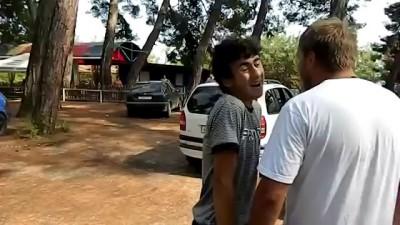 Абхазцы выгоняют русских с парковки.