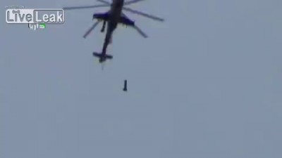 A few meters away from the impact of a Syrian Mi-24 strike