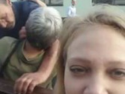 Girl posing for photo captures absolutely brutal fight