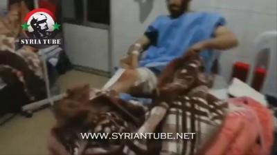 الإرهابي مسلم الشيشاني أمير كتائب جنود الشام يتفقد جرزانه المصابين