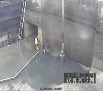 Shock video of two workers overwhelmed by water
