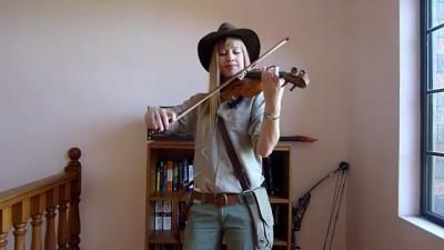 Lara plays the Indiana Jones Theme as Indy (violin)