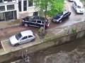 Гонки мажоров в Амстердаме - катер против Порш Кайен