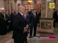Коля Лукашенко в церкви показывает странный знак старшим братьям