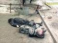18+ В Донецке снаряды попали в остановку и троллейбус, много погибших