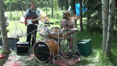 Coolest cop ever playing drums in the woods